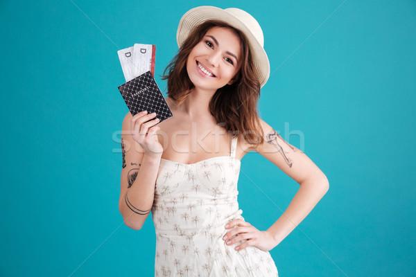 Mutlu gülen genç kız pasaport seyahat Stok fotoğraf © deandrobot