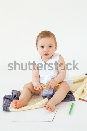 Baby girl sitting on floor near markers and colouring Stock photo © deandrobot