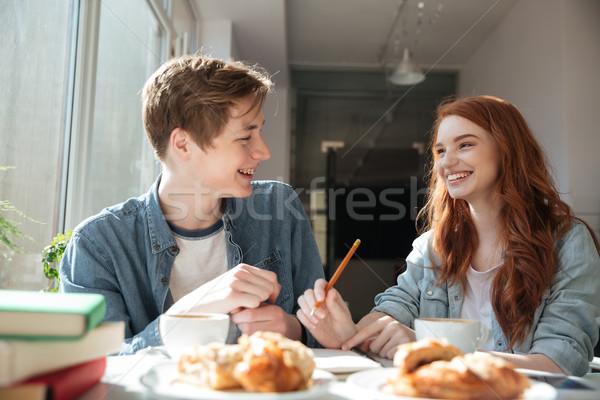 Tiro conversa dois estudantes café bastante Foto stock © deandrobot