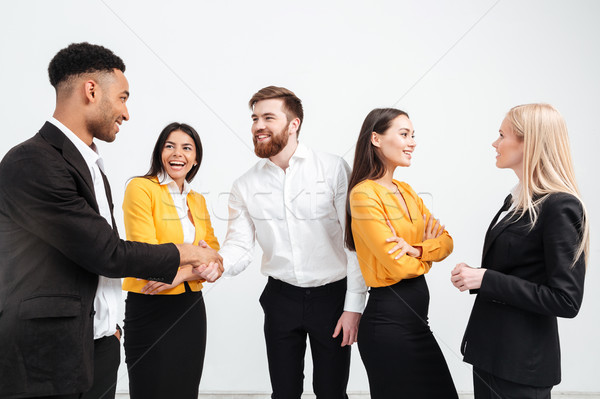 Happy colleagues business team standing in office Stock photo © deandrobot