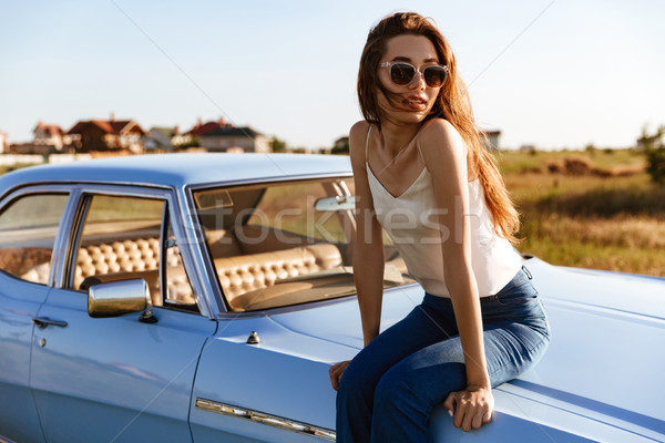 Young pretty woman in sunglasses resting Stock photo © deandrobot