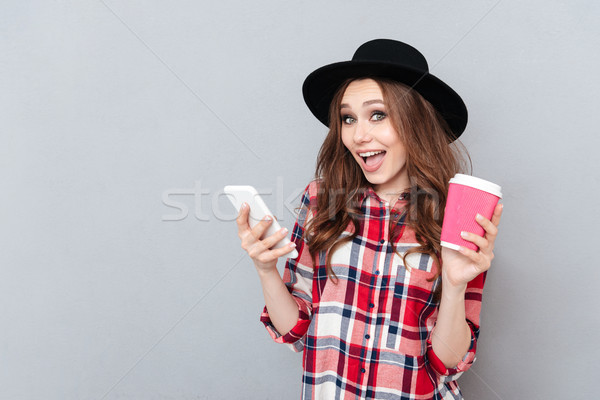 Portrait of a happy excited casual woman in plaid shirt Stock photo © deandrobot