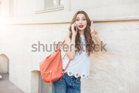 Pretty woman in dress licking knife and looking at camera Stock photo © deandrobot
