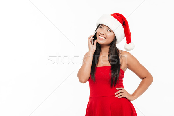 Stock photo: Portrait of a happy asian woman in red christmas costume