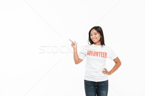 Portrait of a smiling joyful asian woman in volunteer t-shirt Stock photo © deandrobot