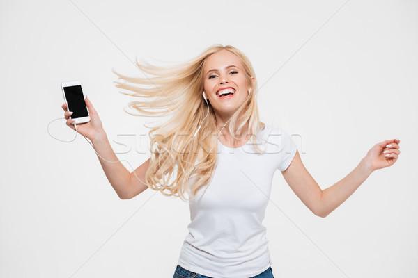 Retrato feliz alegre mulher longo cabelo loiro Foto stock © deandrobot
