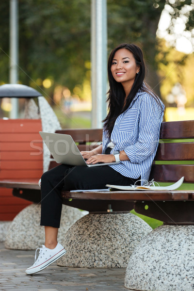 Retrato feliz bastante asiático feminino estudante Foto stock © deandrobot