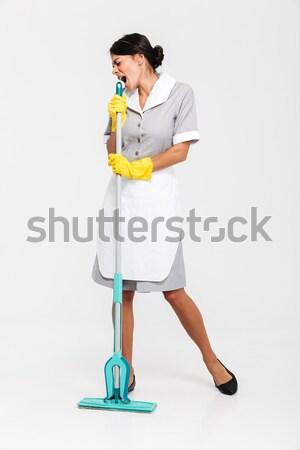 Teljes alakos portré boldog derűs házvezetőnő egyenruha Stock fotó © deandrobot