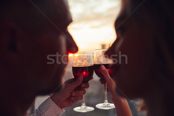 Close up of glasses with wine holding by lovers Stock photo © deandrobot