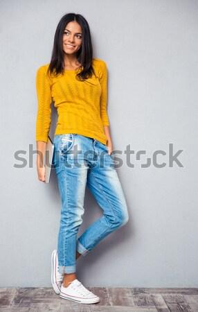 изображение задумчивый брюнетка женщину свитер Сток-фото © deandrobot