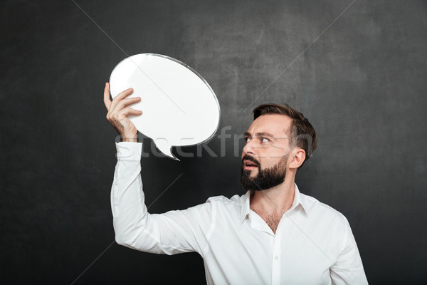 Close up photo of attractive man holding blank message ballon an Stock photo © deandrobot