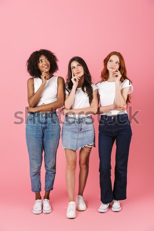 Full-length shot of surprised beautiful ladies looking camera Stock photo © deandrobot