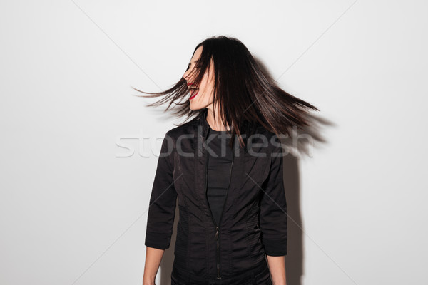 Portrait of a happy woman spinning her head Stock photo © deandrobot