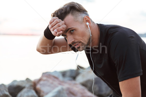 портрет исчерпанный человека спортсмен Сток-фото © deandrobot