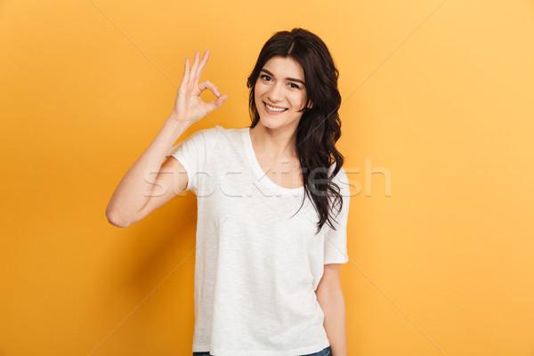 Jeunes dame ok geste Photo stock © deandrobot