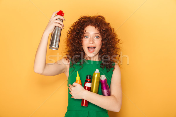 Portrait of a happy curly redhead woman Stock photo © deandrobot