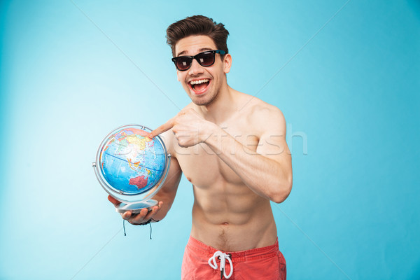 Portrait of a happy young shirtless man Stock photo © deandrobot