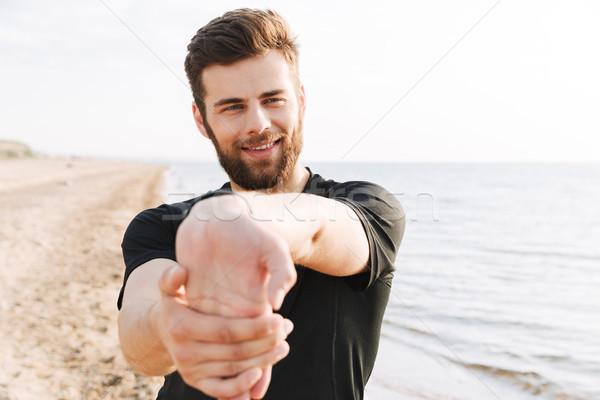 強い 小さな スポーツマン ストレッチング ビーチ 太陽 ストックフォト © deandrobot
