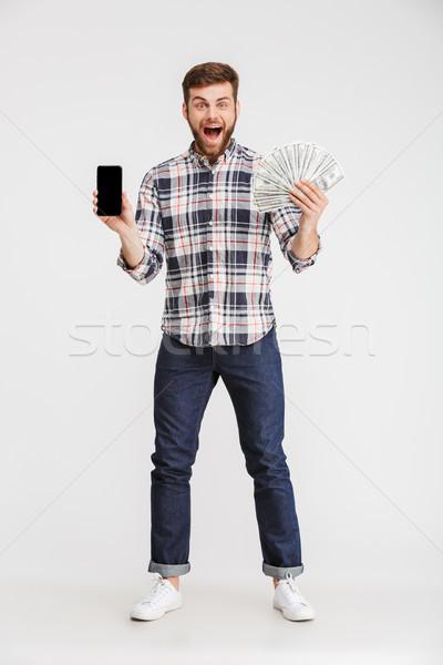 Teljes alakos portré mosolyog fiatalember kockás póló Stock fotó © deandrobot