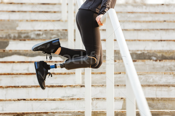 Cropped image of disabled sporty girl with prosthetic leg in spo Stock photo © deandrobot