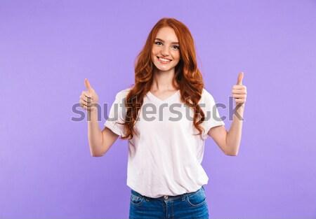 Retrato encantado jovem em pé isolado violeta Foto stock © deandrobot