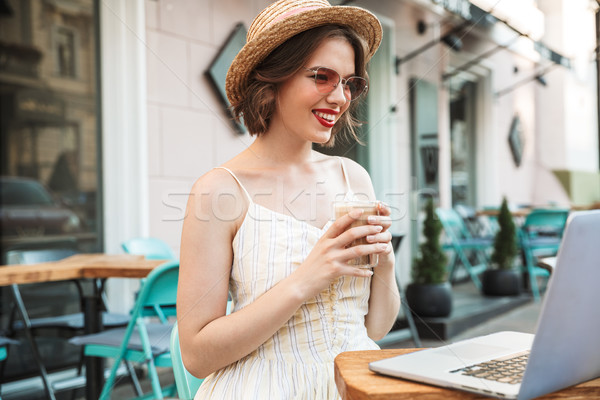 Happy woman in dress and straw hat drinking coffee Stock photo © deandrobot