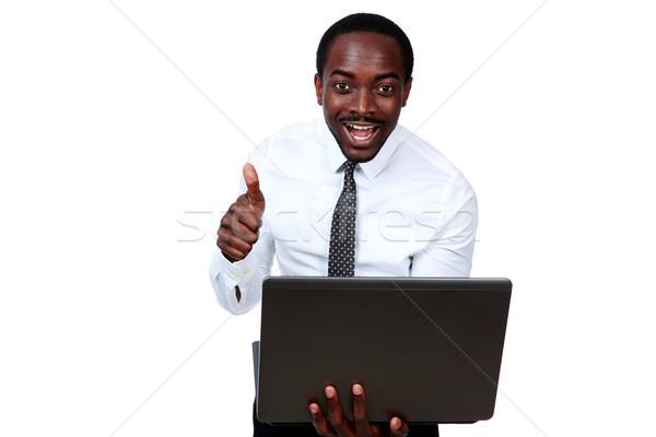 Lachend afrikaanse man laptop tonen Stockfoto © deandrobot