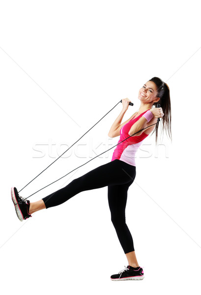 Young cheerful woman with jumping rope over white background Stock photo © deandrobot