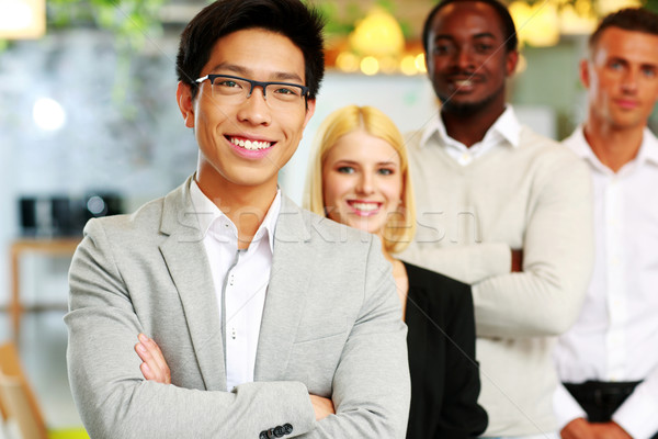 Cheerful group of business people in the office lined up Stock photo © deandrobot