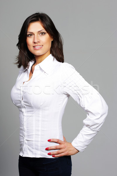 Happy beautiful woman in casual cloths over gray background Stock photo © deandrobot