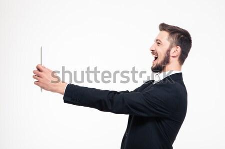 üzletember készít kívánság izolált fehér férfi Stock fotó © deandrobot