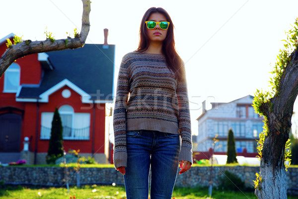 Portrait of a beautiful woman standing in garden Stock photo © deandrobot
