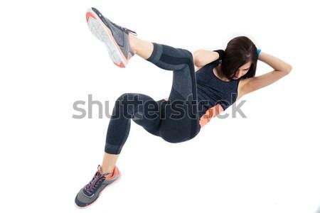 Sporty woman doing abdominal exercises Stock photo © deandrobot