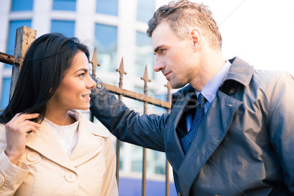 Woman and man flirting outdoors Stock photo © deandrobot