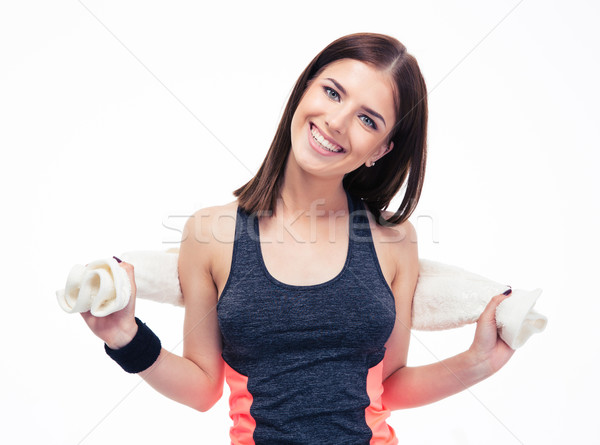 Portrait of a happy sporty woman with towel Stock photo © deandrobot