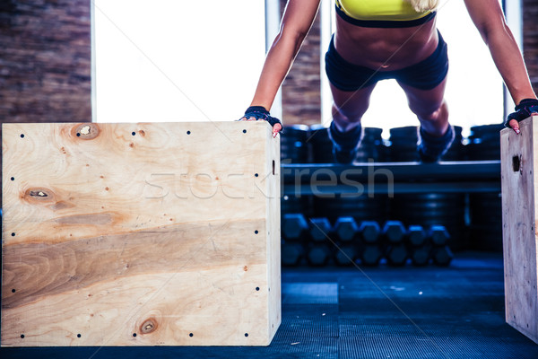 Fit woman doing push ups on fit box Stock photo © deandrobot