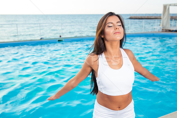 Fitness woman working out outdoors  Stock photo © deandrobot