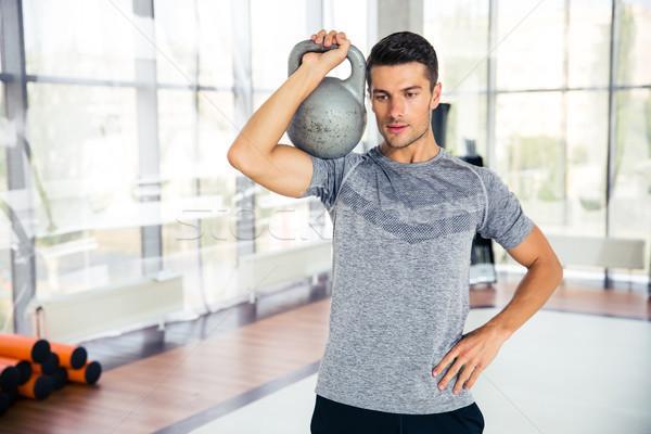 Fitnessz férfi edzés bogrács labda tornaterem Stock fotó © deandrobot