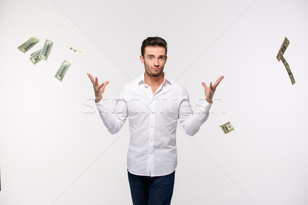 Man throwing money in the air Stock photo © deandrobot