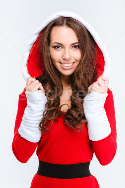 Attractive content girl in red santa claus costume with hood  Stock photo © deandrobot