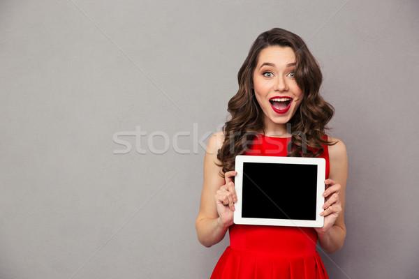 женщину красное платье экране портрет Сток-фото © deandrobot