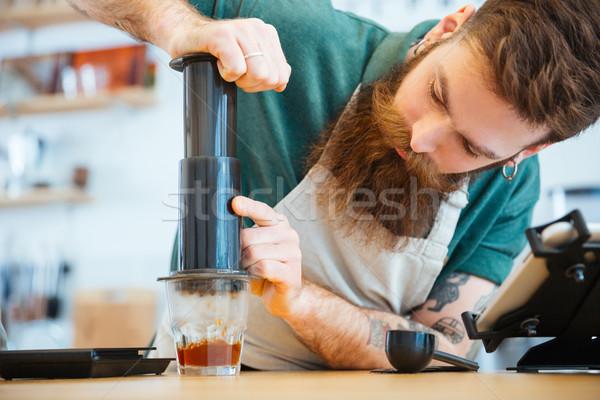 Barista preparing coffee with press Stock photo © deandrobot