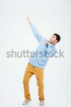Foto stock: Casual · homem · indicação · dedos · algo