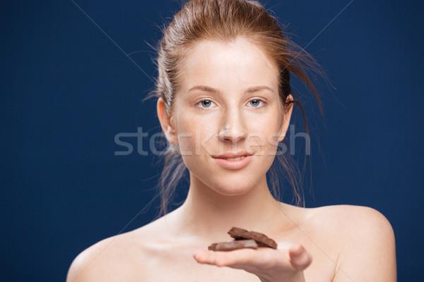 Woman holding chocolate Stock photo © deandrobot