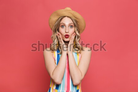 Angry amusing young woman pointing on you  Stock photo © deandrobot