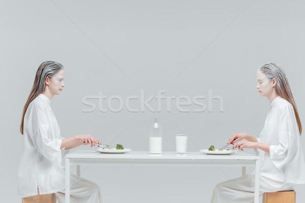 Сток-фото: два · красивой · моде · женщины · обед · таблице