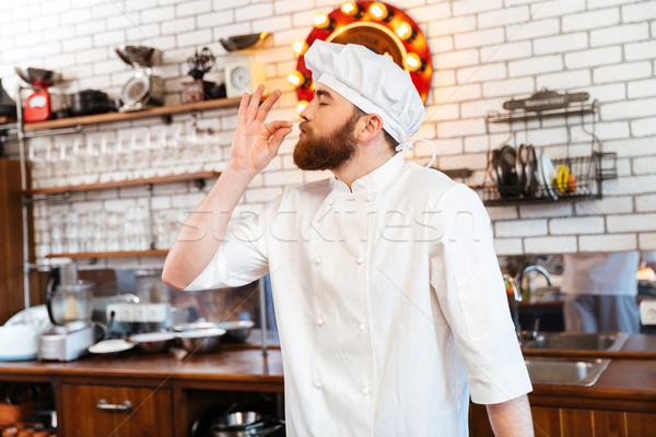 Happy inspired chef cook feeling smell of tasty food  Stock photo © deandrobot