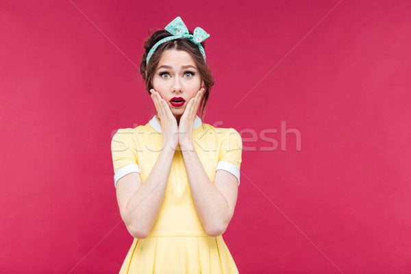 Sad shocked pinup girl in yellow dress Stock photo © deandrobot