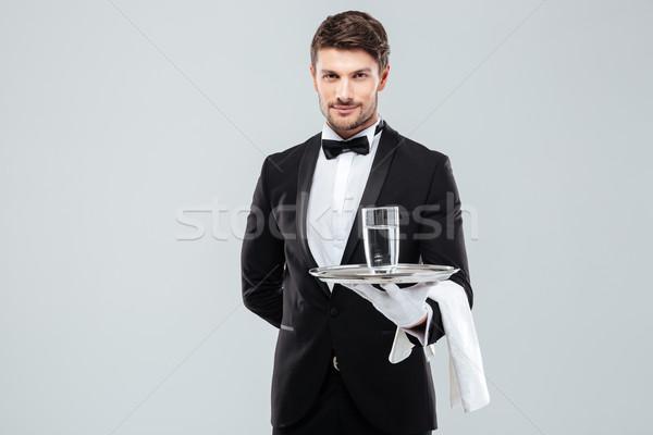 Butler Handschuhe halten Glas Wasser Silber Stock foto © deandrobot