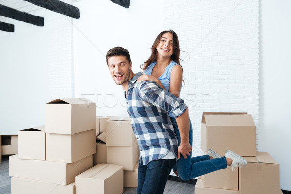Young couple moving in new house Stock photo © deandrobot